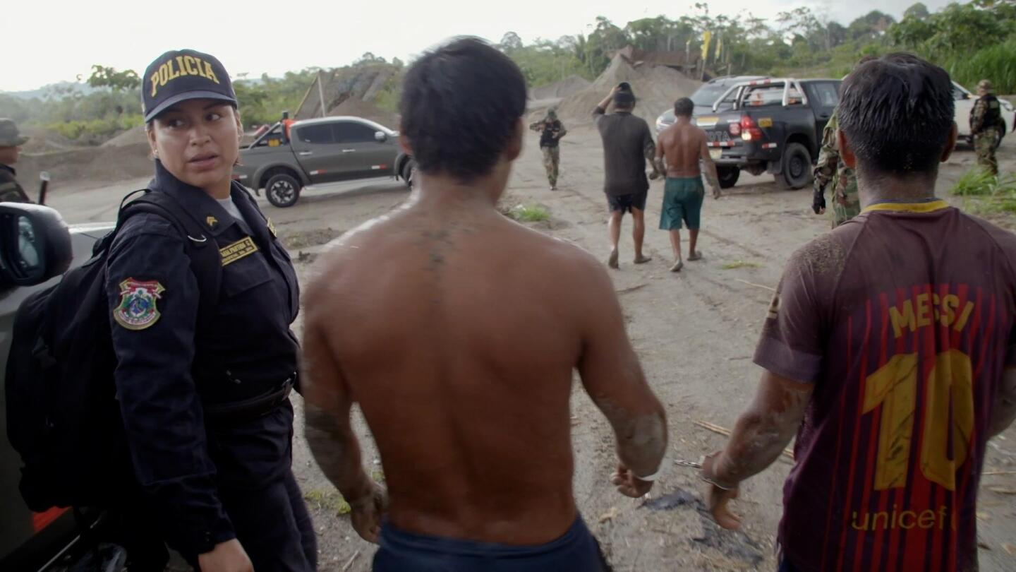 "Mine workers being arrested by environmental police in Peru. | Still from ""Earth Focus"""