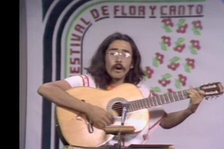 Juan Felipe Herrera performs his poetry accompanied by guitar at Flor Y Canto in 1973