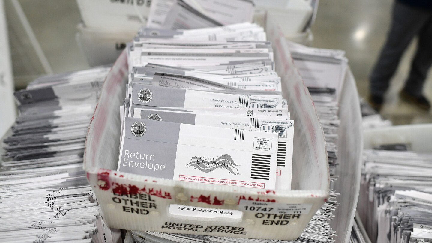 Mail-in ballots in their envelopes await processing at the Los Angeles County Registrar Recorders' mail-in ballot processing center at the Pomona Fairplex in Pomona, California, October 28, 2020. | ROBYN BECK/AFP via Getty Images