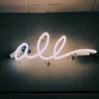 "White neon sign that reads ""all."" | Jon Tyson / Unsplash"
