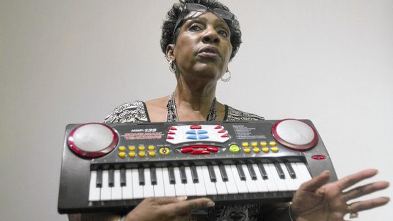 Arvis Jones Hathaway holding an electronic keyboard