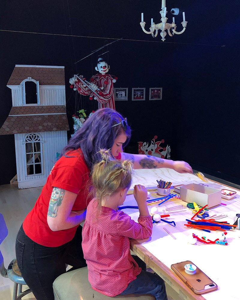 Missy Steele helps a child make a puppet at the OxyArts and Kidspace Summer Camp in 2019. | Courtesy of Missy Steele