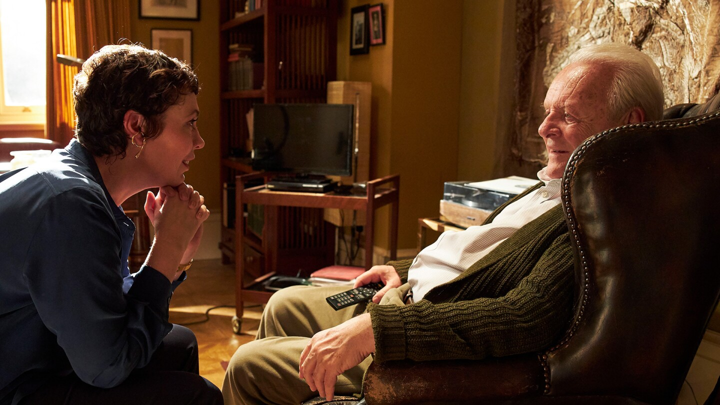 "Olivia Coleman and Anthony Hopkins look at each other in a scene from ""The Father."""