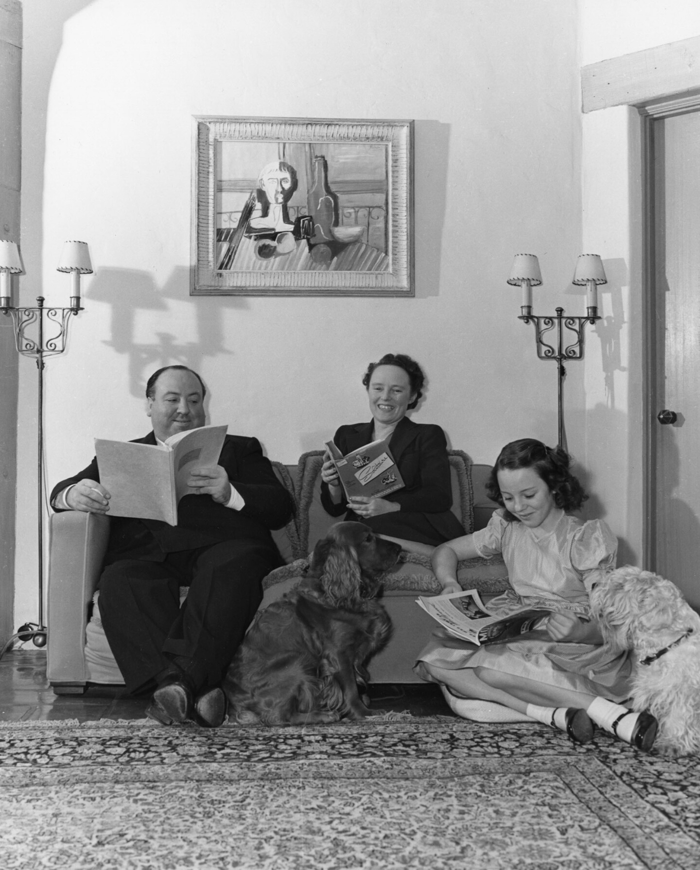 Alfred Hitchcock with his wife Alma Reville and their daughter Patricia Hitchcock at their California home, ca. 1941.