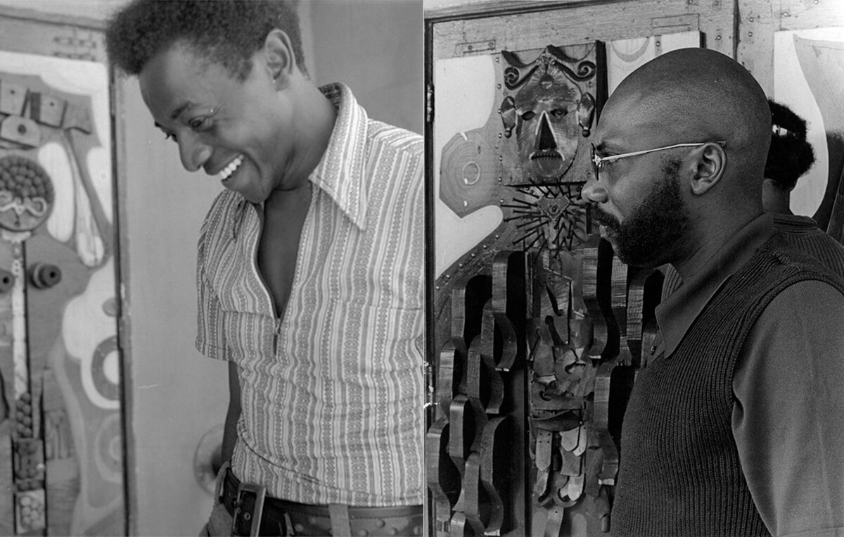 Elliott Pinkney and John Outterbridge stand at The Arena's doors, which are decorated with assemblage art made of iron, wood, and other materials. | Courtesy of Willie Ford, Jr. and the Compton Communicative Arts Academy Collection, Special Collections and Archives, John F. Kennedy Memorial Library, California State University, Los Angeles