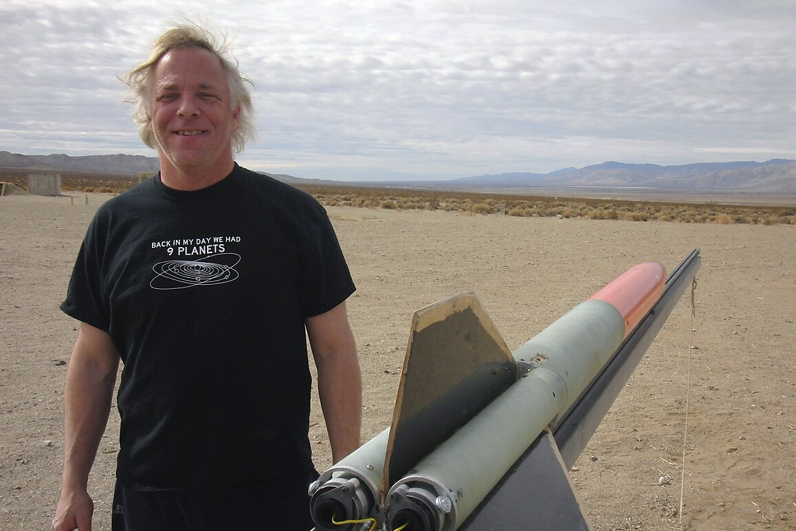 Paul Breed Sr. with rocket at FAR, Cantil, CA. | Courtesy of FAR