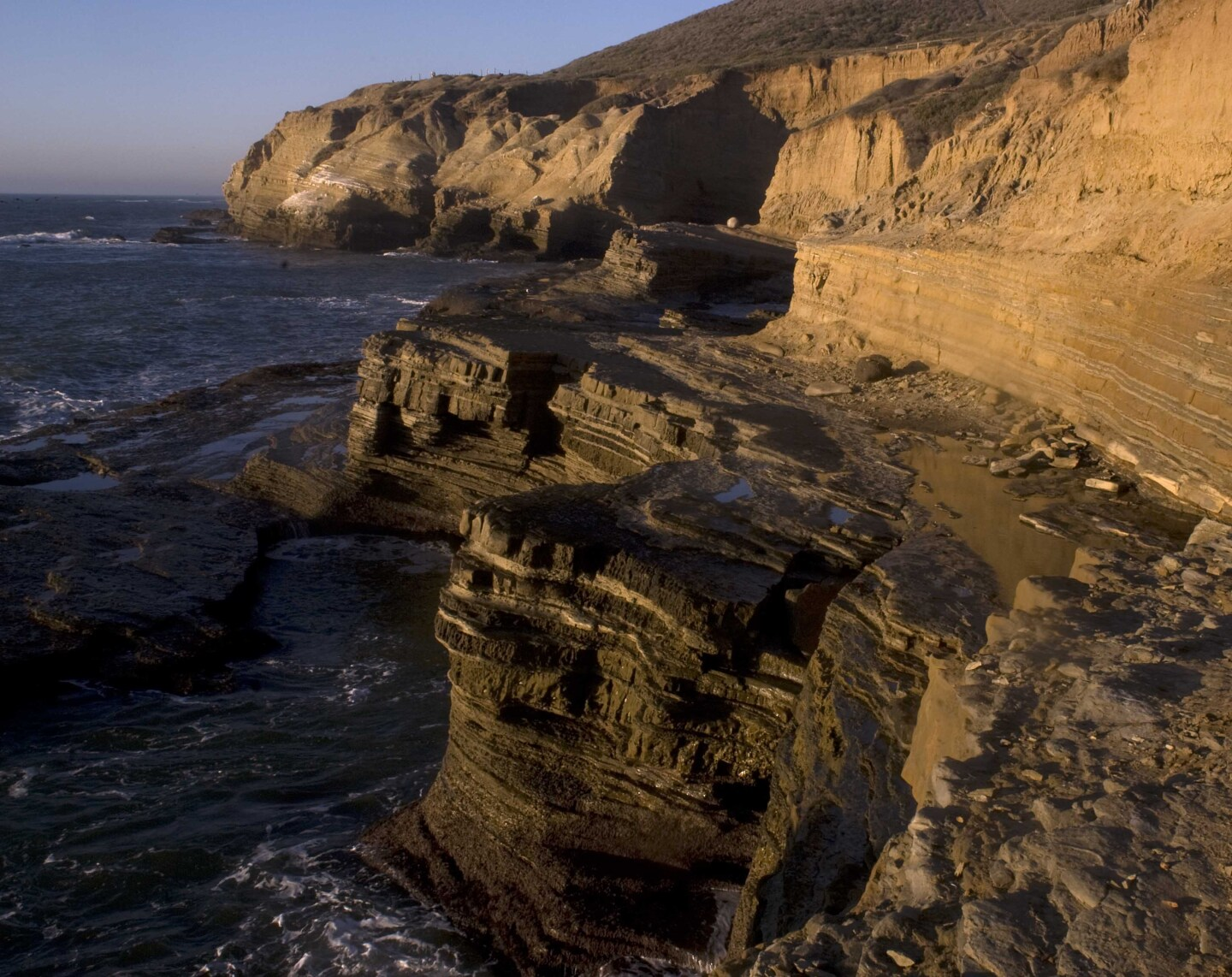 View of sandstone cliffs above the ocean