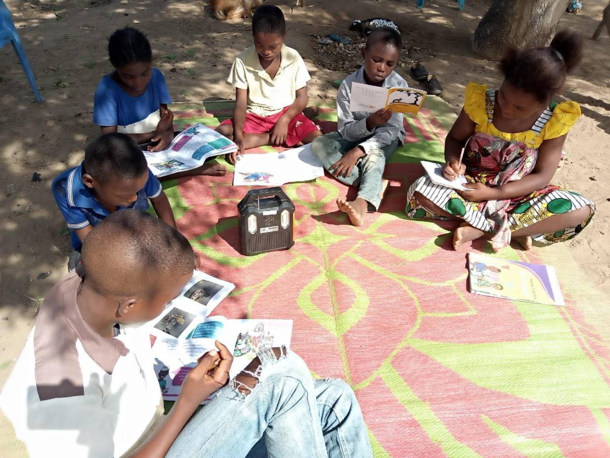 Pupils listen to school lessons broadcast over a solar radio in Dalu village, Tana River County, Kenya, November 28, 2020. Thomson Reuters Foundation | Benson Rioba