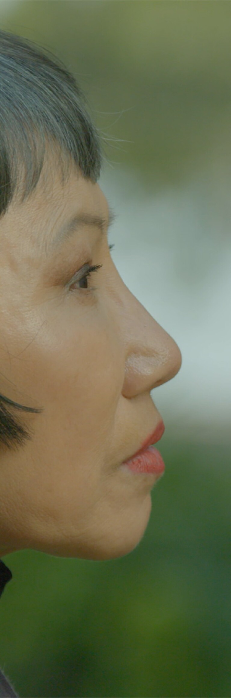 Side profile of Amy Tan.