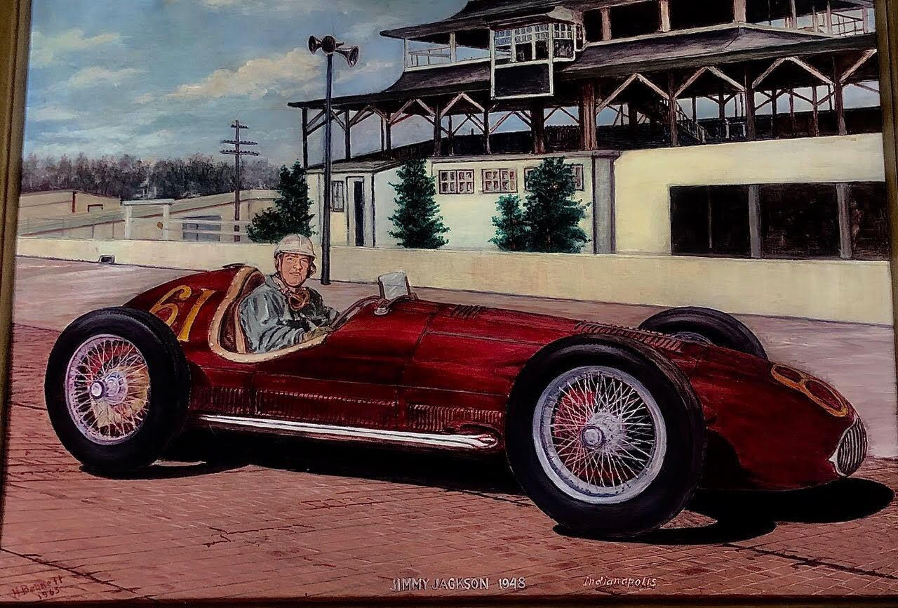 A painting of Jimmy J.J. Jackson sitting in a narrow 1948 red race car.