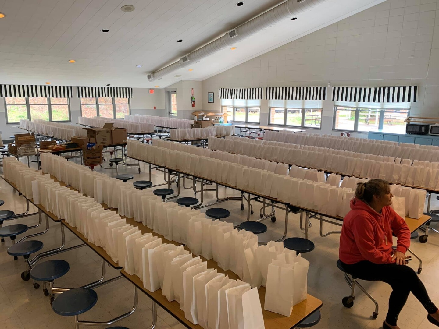 Prepared breakfast and lunch meals waiting to be picked-up by buses for home deliveries in Swain County, North Carolina | Courtesy of Christine Tran