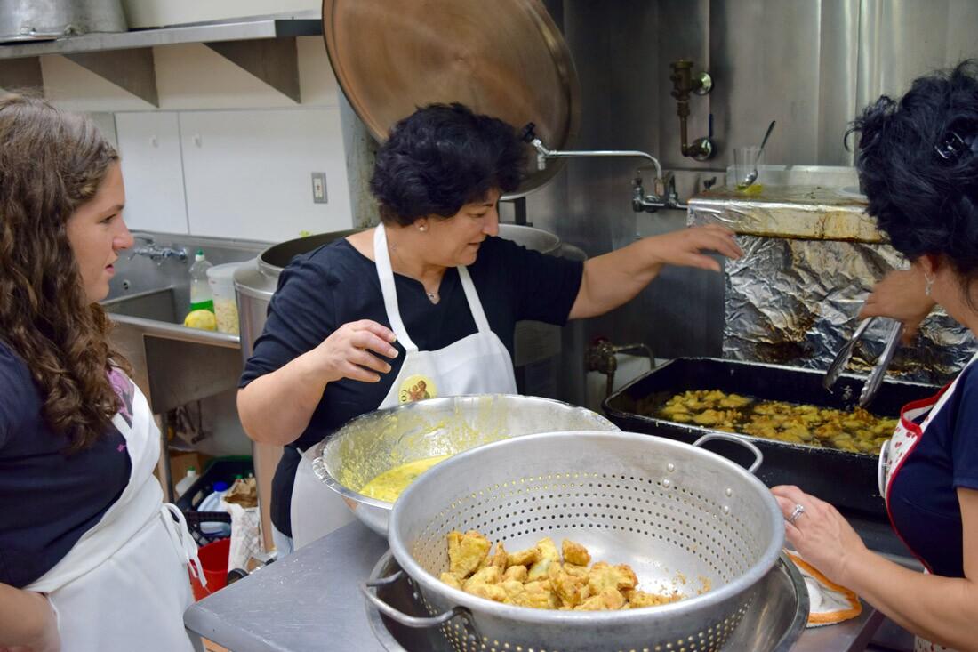 Preparing fried artichokes for the feast, St. Joseph's Table