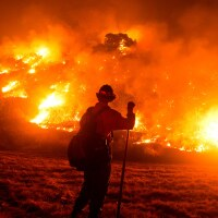 A firefighter works at the scene of the Bobcat Fire burning on hillsides near Monrovia Canyon Park in Monrovia, California on September 15, 2020.   Photo by RINGO CHIU/AFP via Getty Images