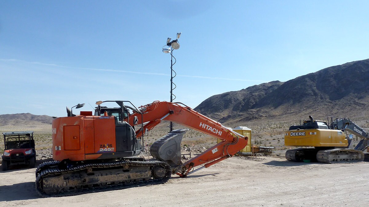 Several excavators and a floodlight sit along the border in Skull Valley. | Craig Deutsche