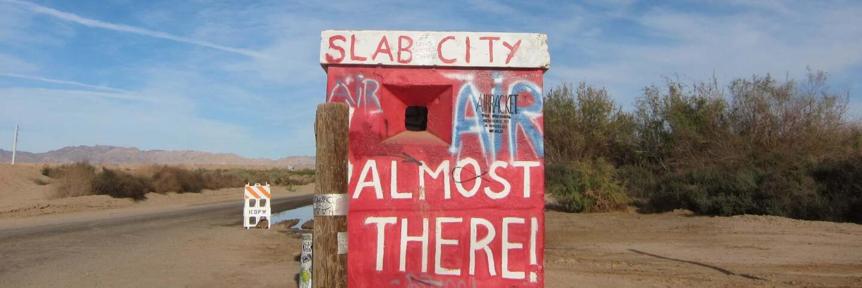 Slab City sign   Jean Trinh Desert X AB s9
