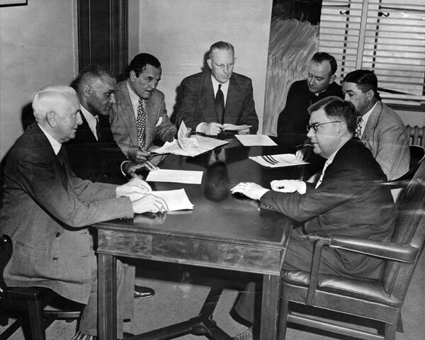 Governor Earl Warren meets with an ad-hoc citizens committee formed to discuss plans to prevent a recurrence of the Zoot Suit Riots. Courtesy of the Herald-Examiner Collection, Los Angeles Public Library.