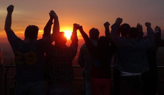 Raising hands for Huell Howser at sunset.   Photo: Zach Behrens/KCET