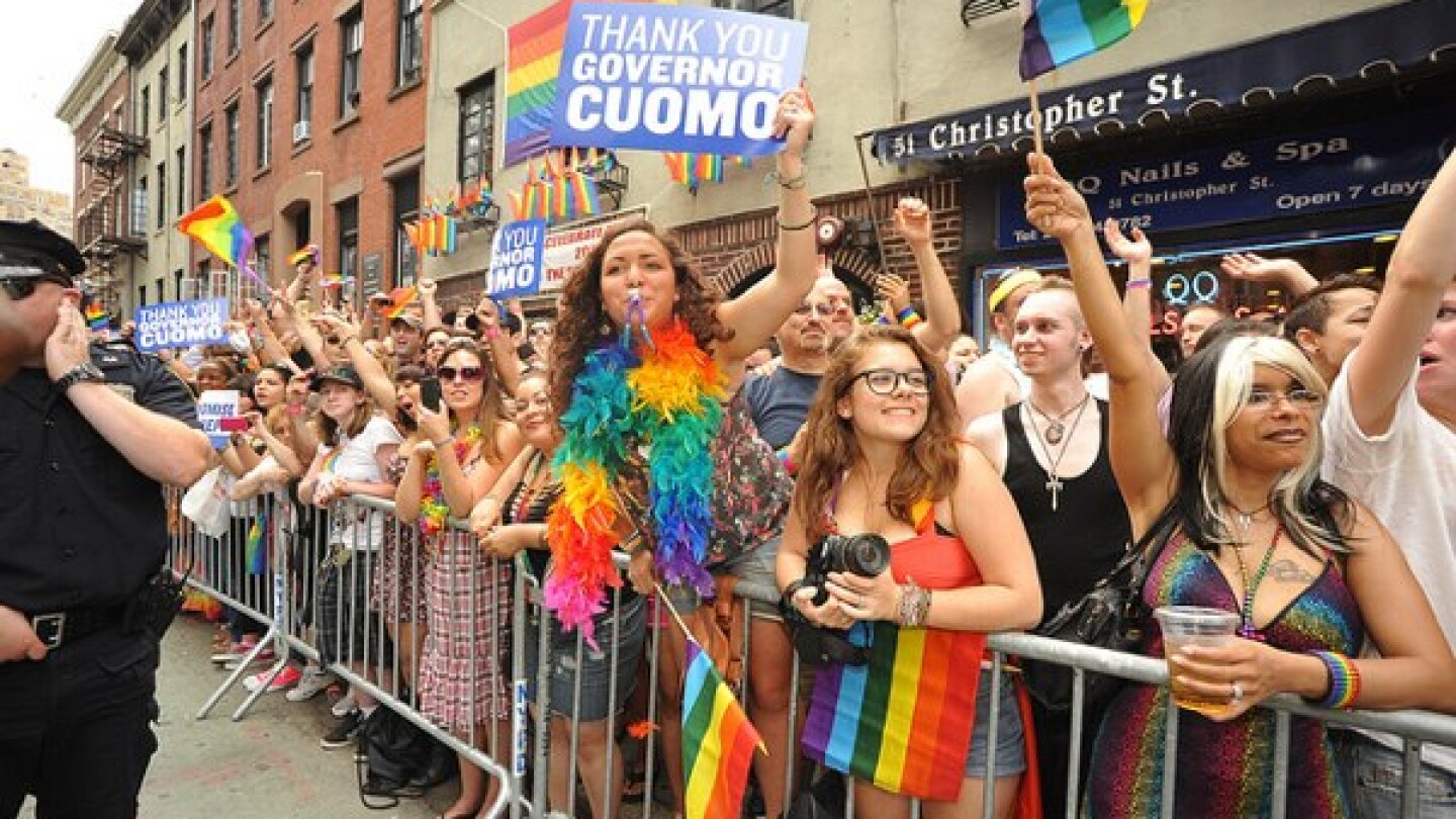 Gay pride parade celebrating the Passage of the marriage equalitylLaw in Greenwich Village, New York City