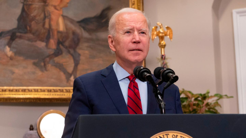 President Biden stands behind a lectern.