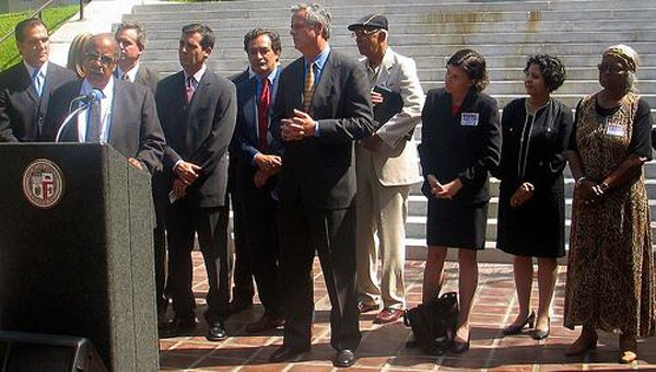 Grass roots and city leaders at the 2004 Settlement Press Conference | Photo courtesy of The City Project