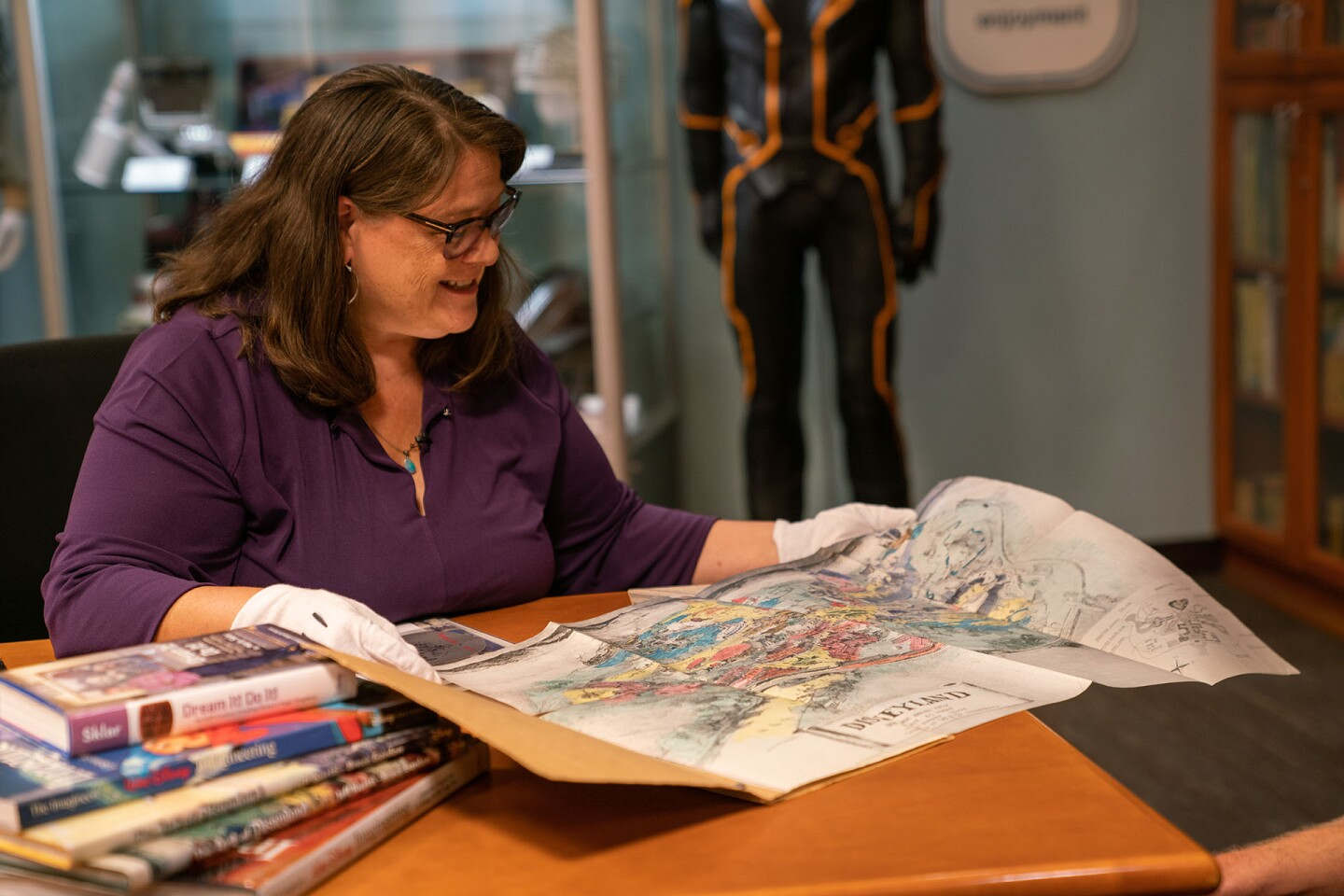 Rebecca Cline unfolds the hand-drawn sketch that started the Disneyland | Katie Noonan