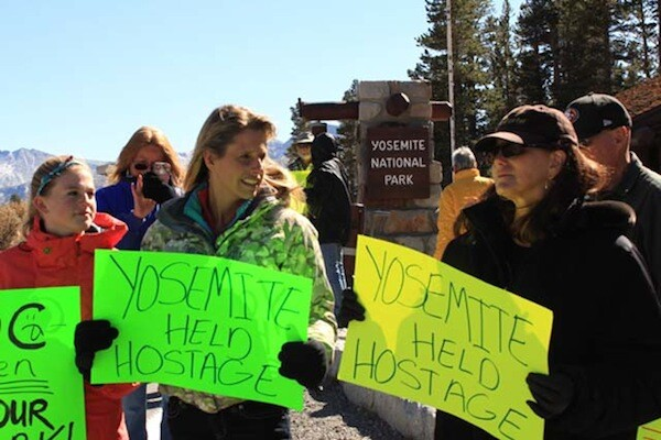 Occupy Yosemite organizer Stacey Powells, right, holds a sign next to Mammoth Lakes resident Jennifer DeAngelis.   Photo: Dan McConnell