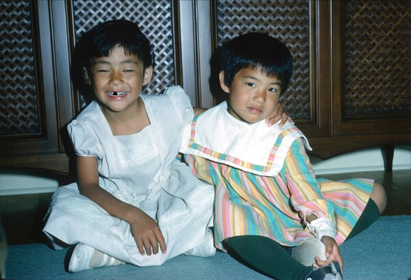 Me with my younger sister, back in the day.   Image: George Chong / My sister and I enjoying an evening at home.<br />