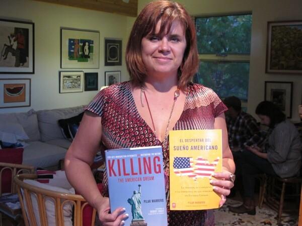 Pilar Marrero holds her books. | Photo: Adolfo Guzman-Lopez