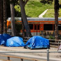Tents housing homeless over a bridge | iStock