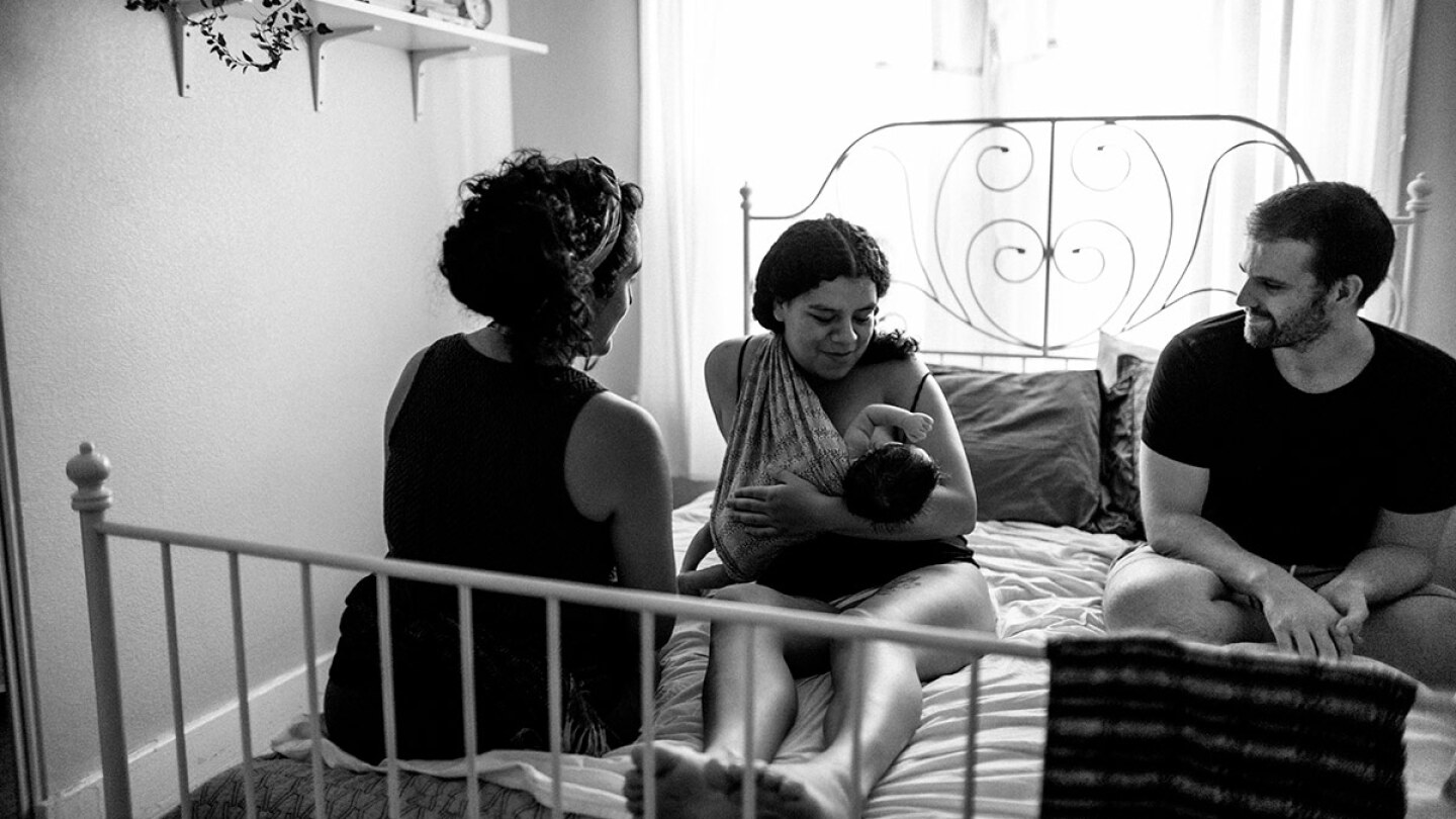Panquetzani sits with new parents and their baby. | Samanta Helou Hernandez