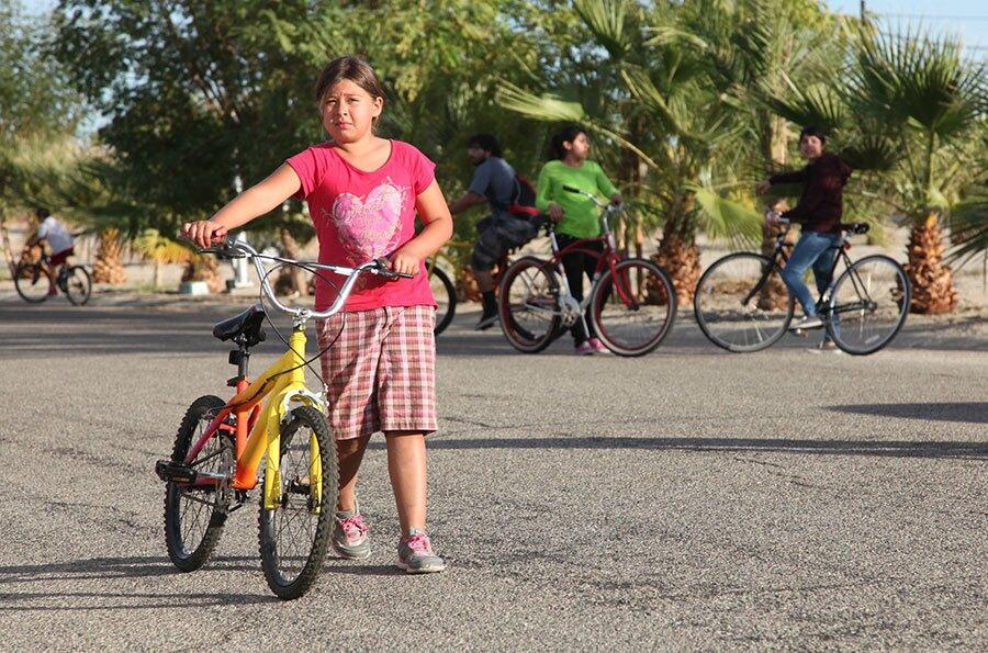 Biking between sites   Photo: Drew Tewksbury