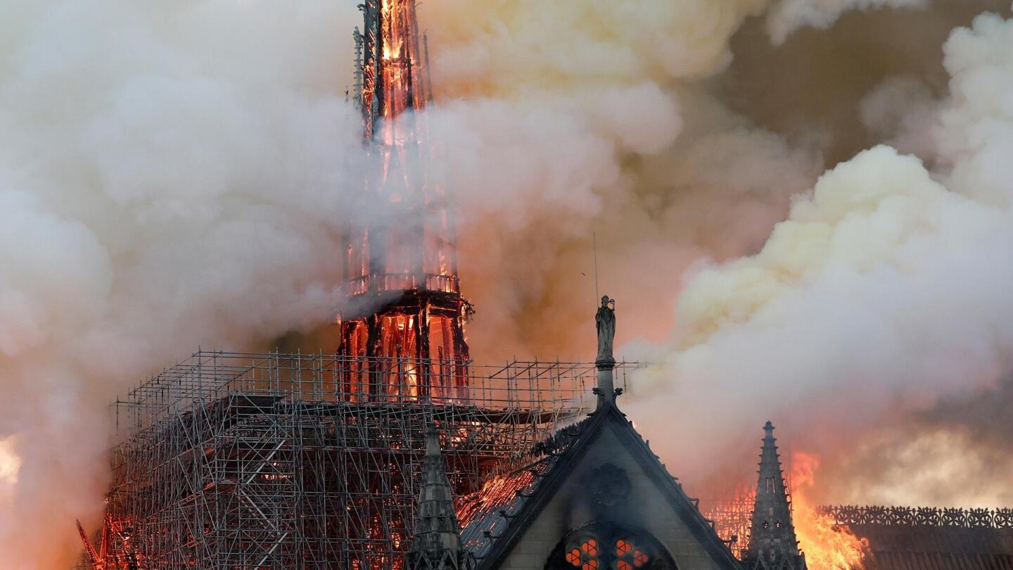 "The Cathedral of Notre Dame on fire, smoke enshrouding the areas around it. | From ""NOVA: Saving Notre Dame"""