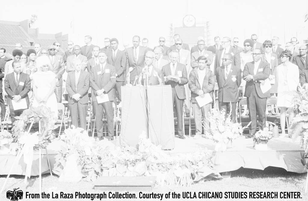 CSRC_LaRaza_B12F10C1_STAFF?__014 A man on stage during a Martin Luther King Jr. Memorial in Los Angeles | La Raza photograph collection. Courtesy of UCLA Chicano Studies Research Center