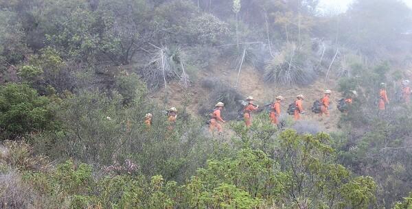 Inmates hiking a trail called Backbone.