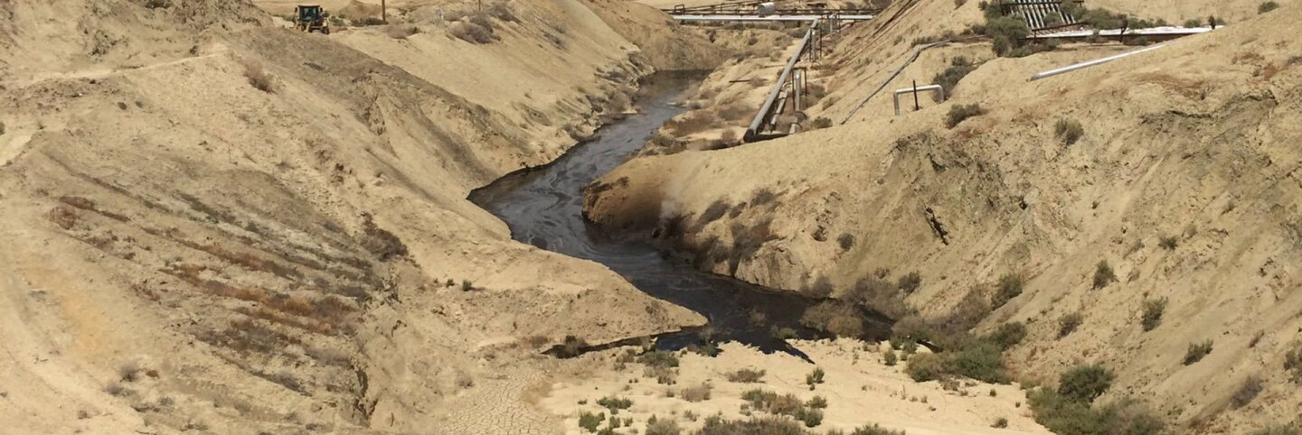 """Photograph of """"crude oil surface expression"""" at Cymric Oil Field. 