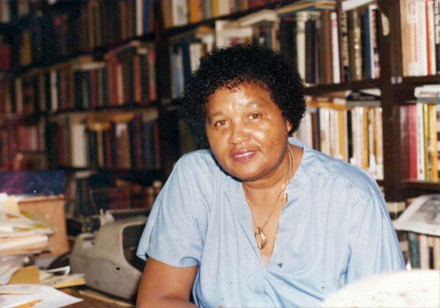 Mayme Clayton in library