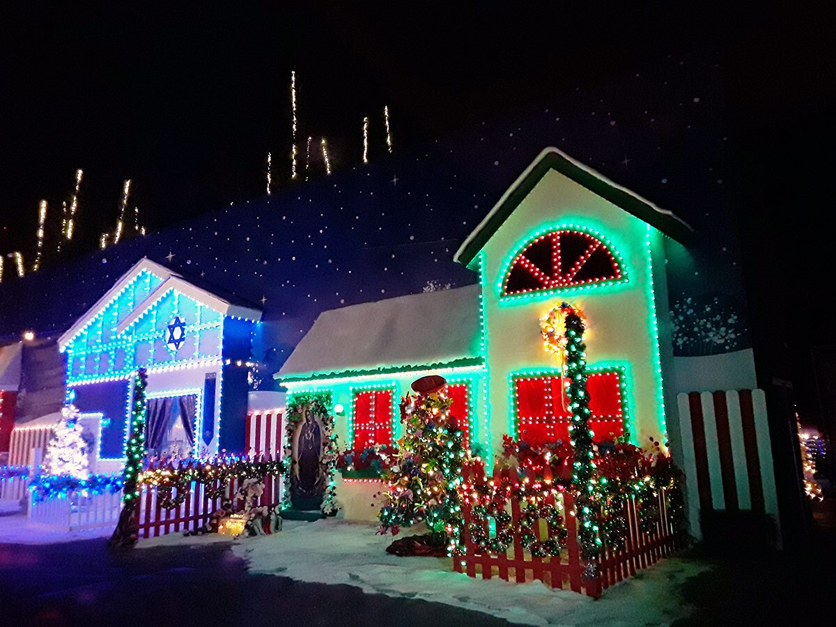 Small houses highly decorated with colorful lights at at WonderLAnd at Westfield Topanga & The Village. | Sandi Hemmerlein