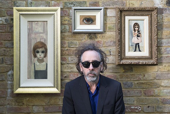 """""""Big Eyes"""" director Tim Burton posing with Margaret Keane paintings.   Photo courtesy of The Weinstein Company."""