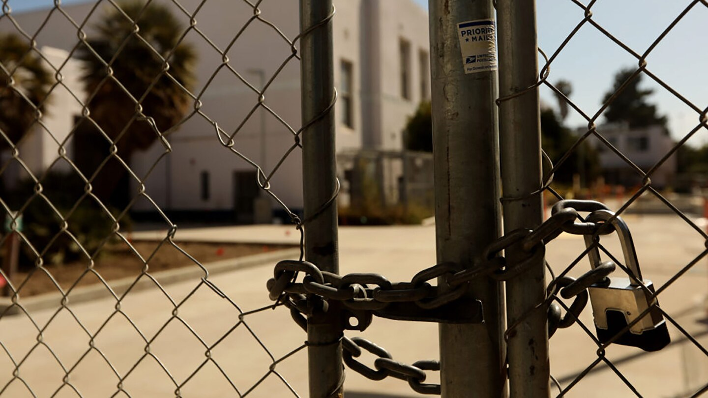 A padlock keeps the campus of Venice High School shuttered in Venice on July 13, 2020.