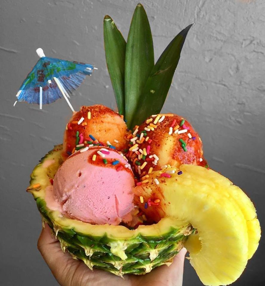 Triple scoop pineapple sundae with exotic fruit vegan and dairy flavors   Courtesy of Helados Pops