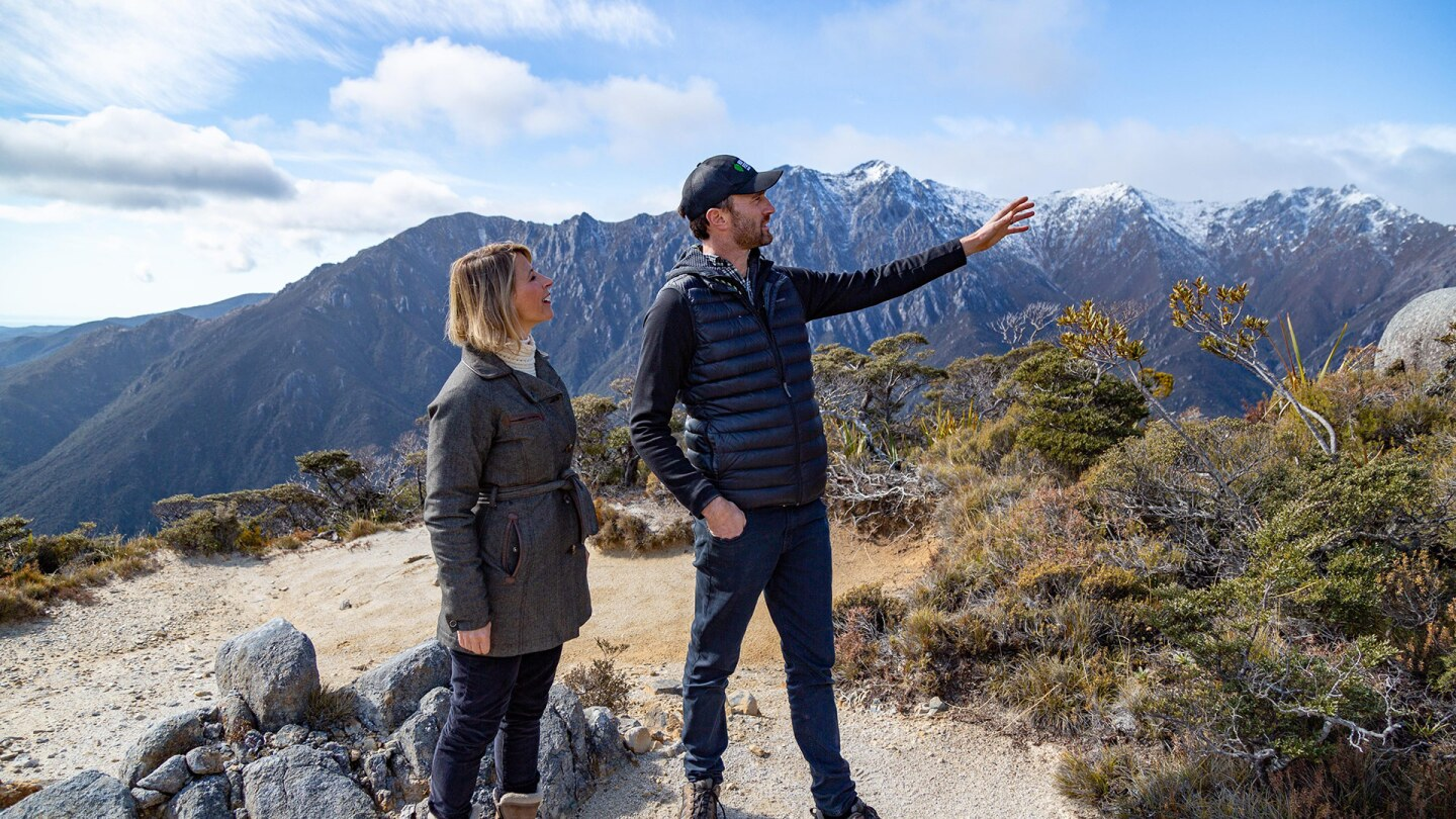 Samantha Brown looks where her guide in New Zealand is pointing.