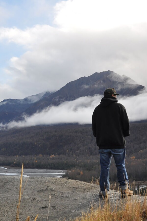 A man stands at an overlook.