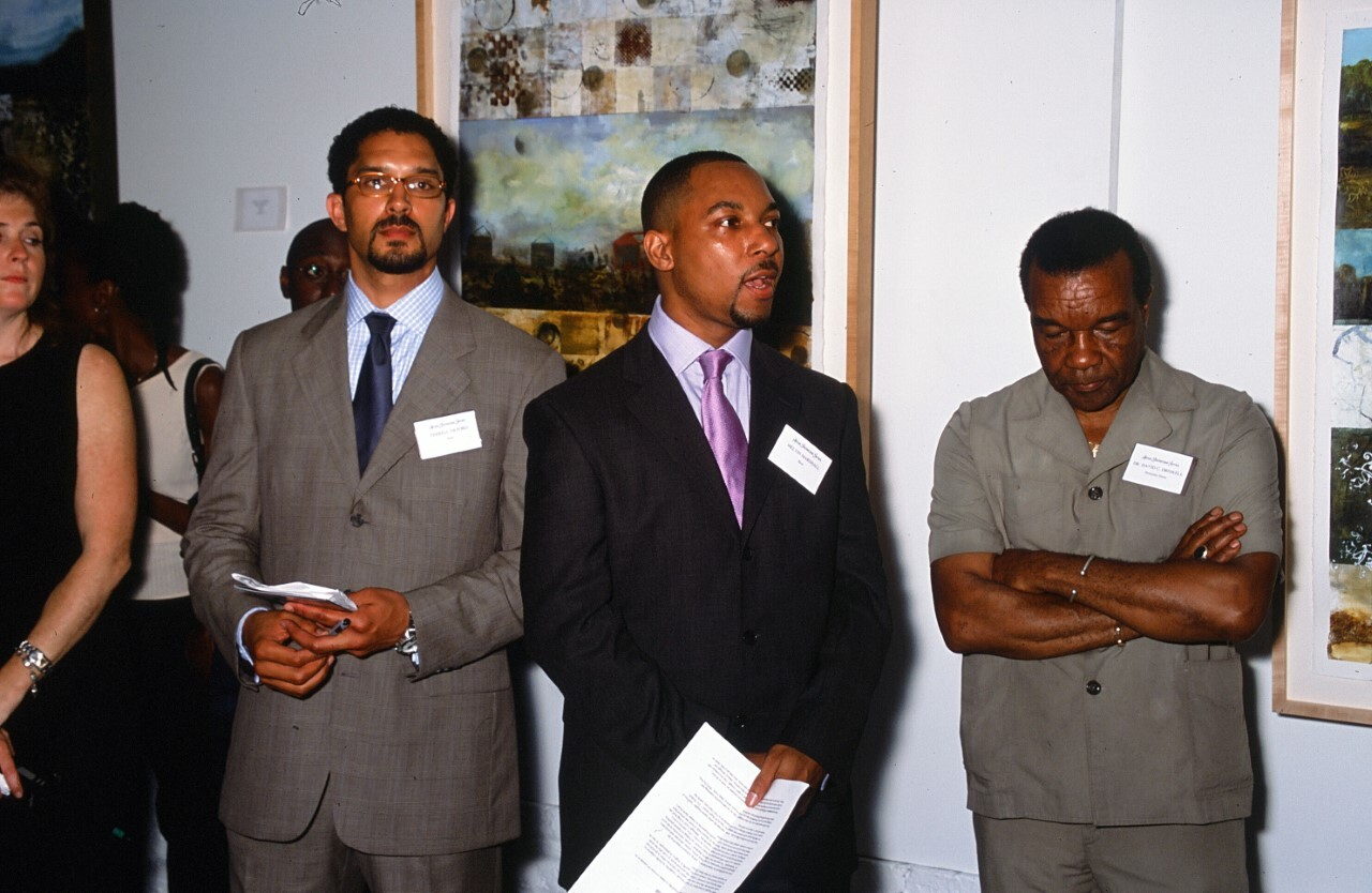 Terrell Tilford (left) and Melvin Marshall (right) during the first show they co-curated together June 1999. On the far right is their mentor Dr. David C. Driskell (June 7, 1931-April 1, 2020). | Courtesy of Melvin Marshall