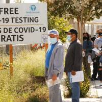 Walk-ins wait for Coronavirus Covid-19 testing in LA County at the Charles R. Drew University of Medicine and Science in South Los Angeles on July 8, 2020. | Al Seib / Los Angeles Times via Getty Images