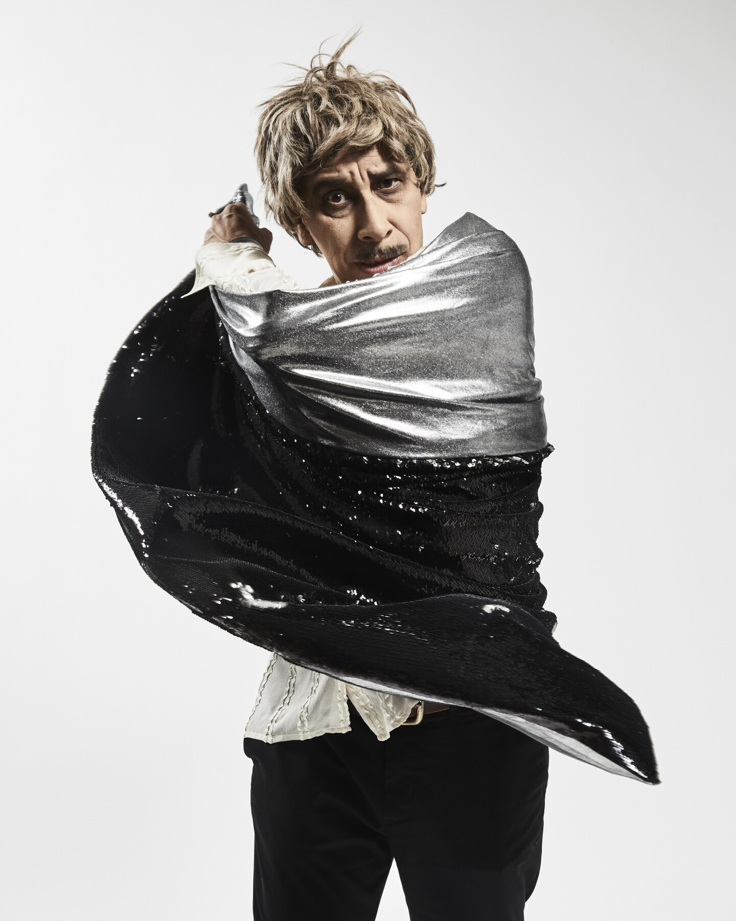 Kid Congo Powers wrapped in a glittery silver cape
