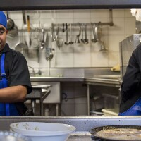 Dishwashers Esteban Soc, left, and Joselino Aguilar, right, at work in the kitchen of Mexican restaurant Caracol in Houston, Texas. | Scott Dalton for The Washington Post via Getty Images