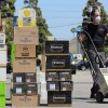 Employee with a hand truck moves shipments of alcohol into warehouse | Karen Foshay