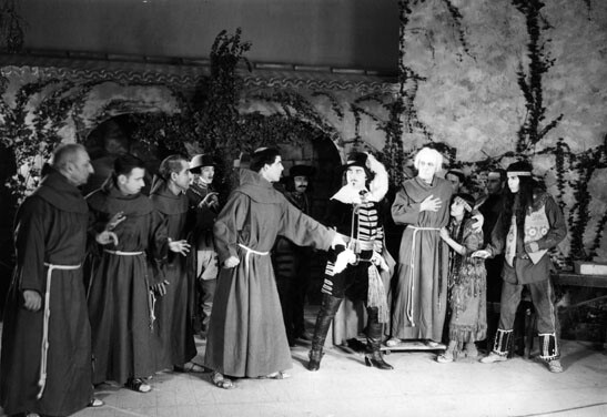 In this scene from 'The Mission Play,' Serra (white hair) and other mission fathers protect an Indian from a Spanish soldier. Courtesy of the Los Angeles Public Library Photo Collection.