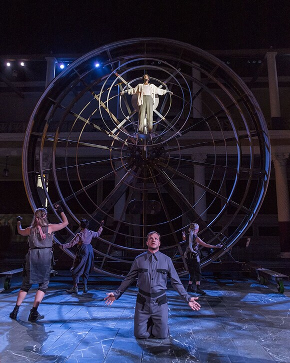 Michael Blackman as Hermes with Prometheus and Chorus members.  Prometheus Bound at the Getty Villa. | Photo: © 2013 Craig Schwartz.