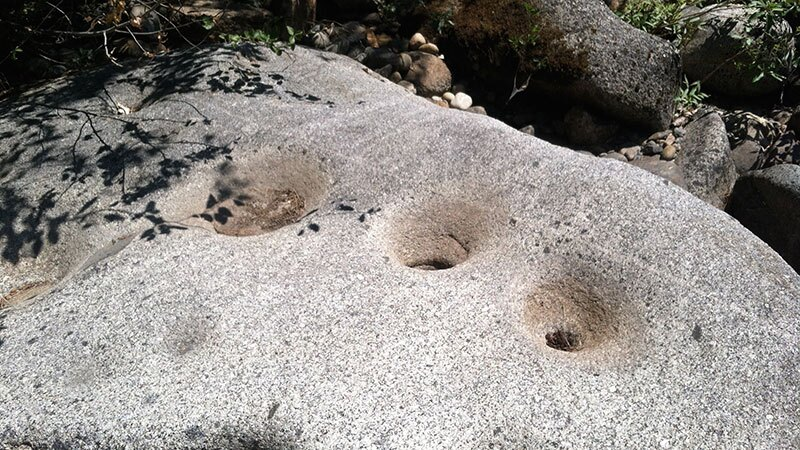 Bedrock mortars at Dinkey Creek. The existence of these and many other mortars demonstrates long-term Indigenous residence in a productive landscape. |Photo:Jared Dahl Aldern